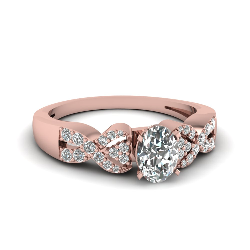 Rose Gold Oval Shaped Diamond Engagement Ring With Pave Set
