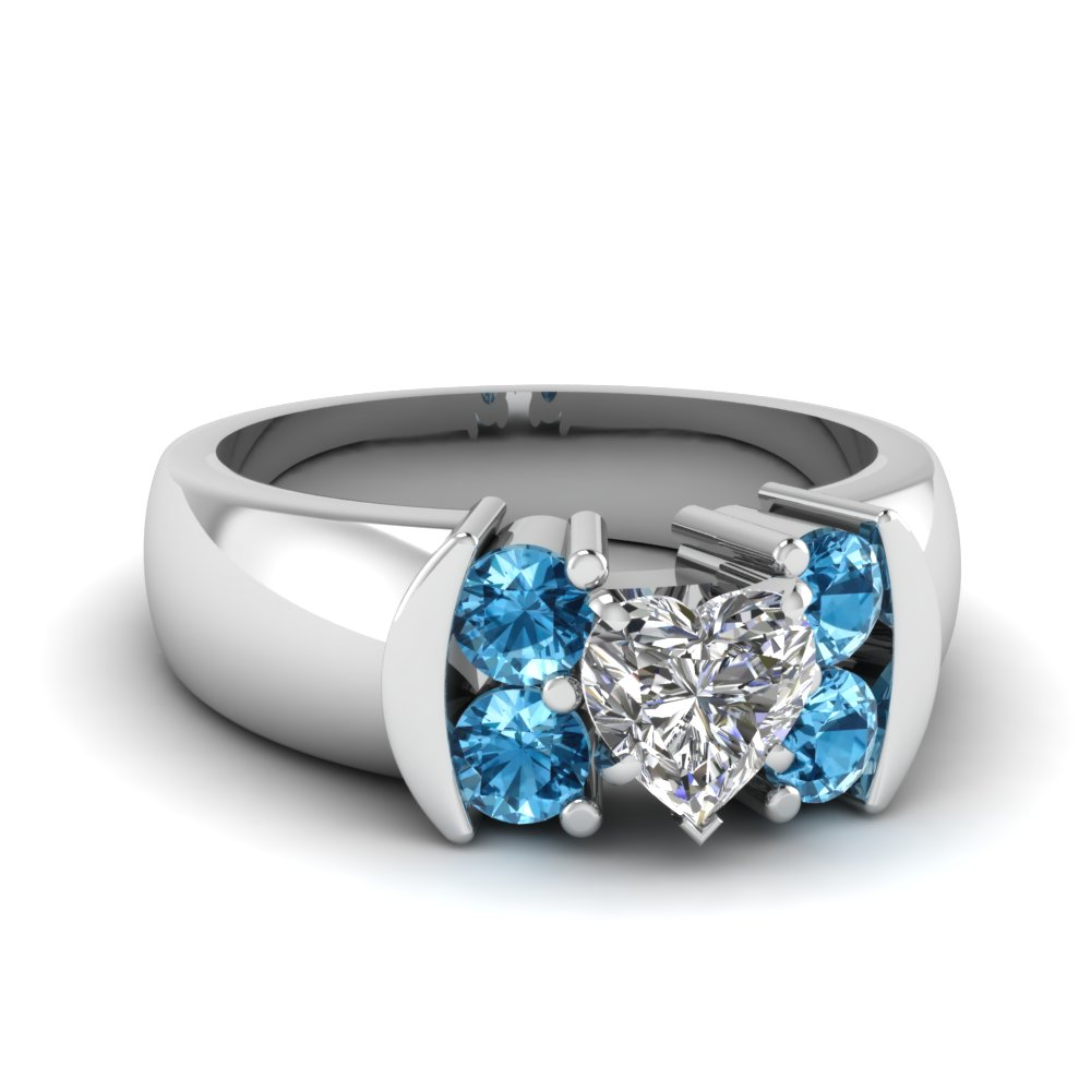 Heart Shaped Blue Topaz Side Stone Engagement Ring