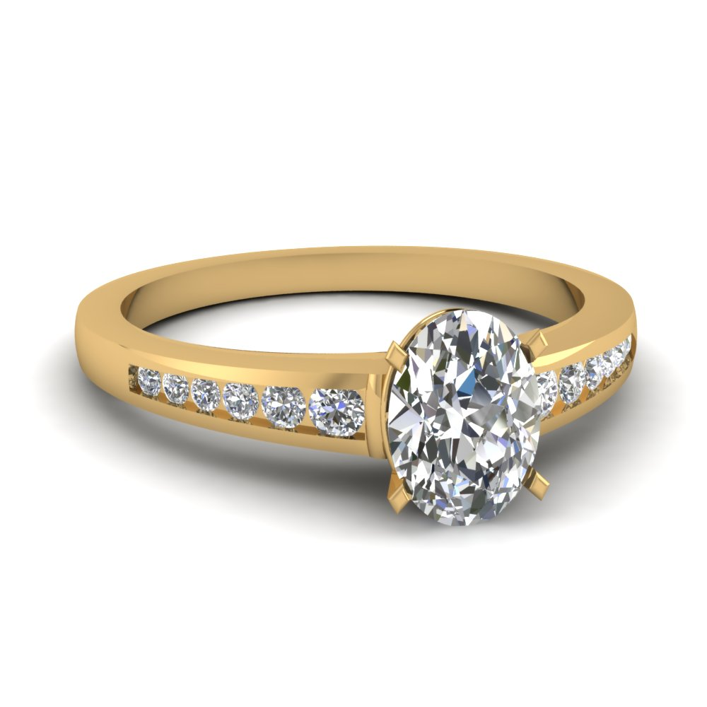 Oval Shaped Diamond Engagement Rings With White Diamonds In 14k Yellow Gold